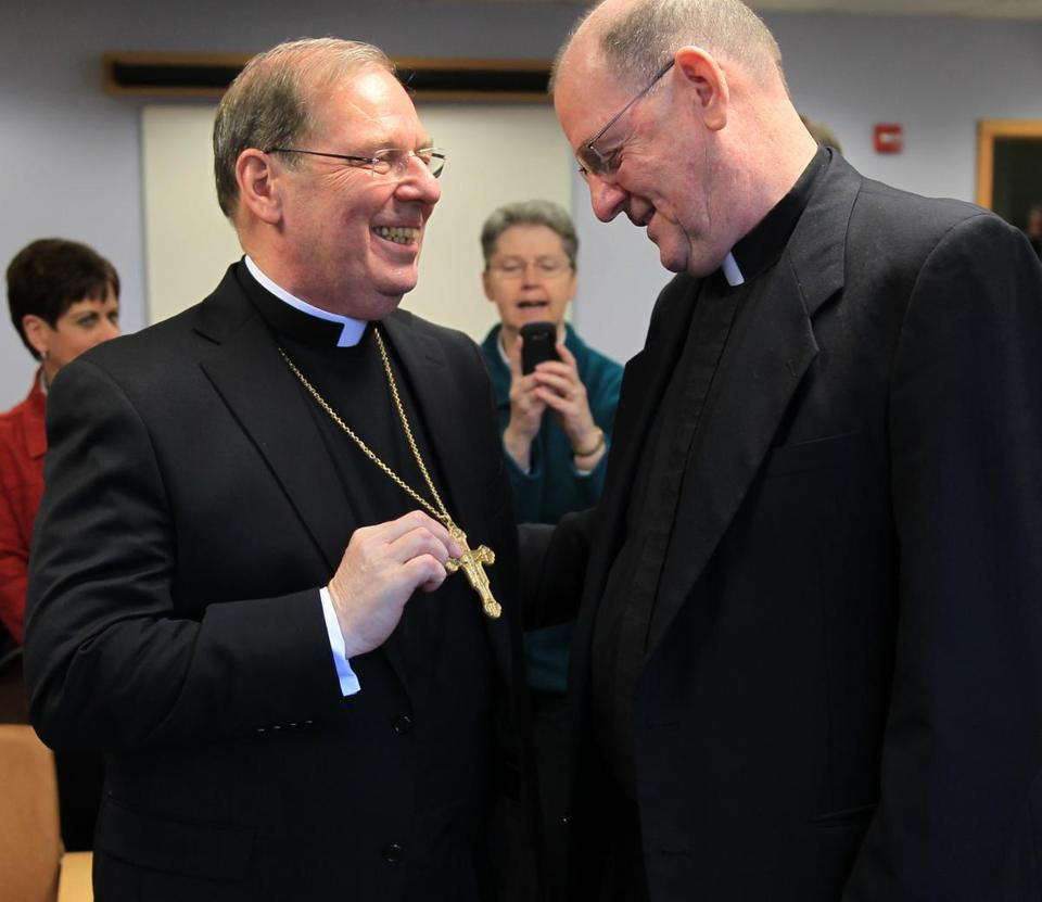 Monsignor Robert P. Deeley (left), named an auxiliary bishop, chatted with his brother, the Rev. Kevin J. Deeley.