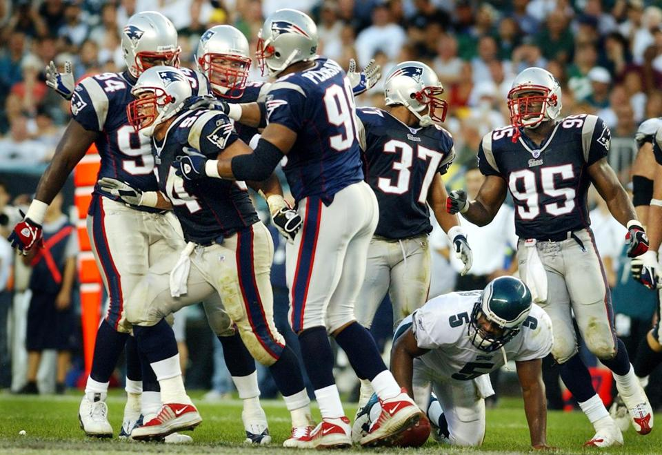 Tedy Bruschi, (54) celebrated a fourth-quarter sack of Donovan McNabb.