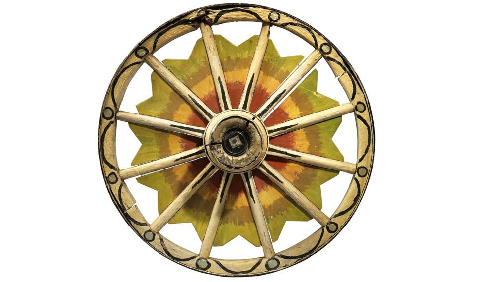 A late-19th-century painted wood and metal circus wagon wheel.