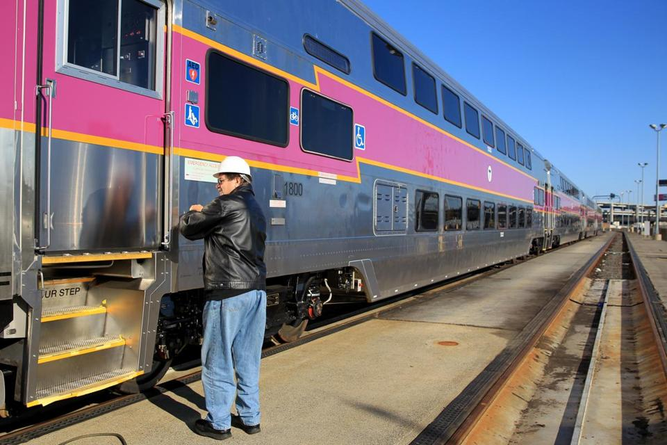 Paul Hanlon of the Massachusetts Bay Commuter Railroad looked at a new rail coach.