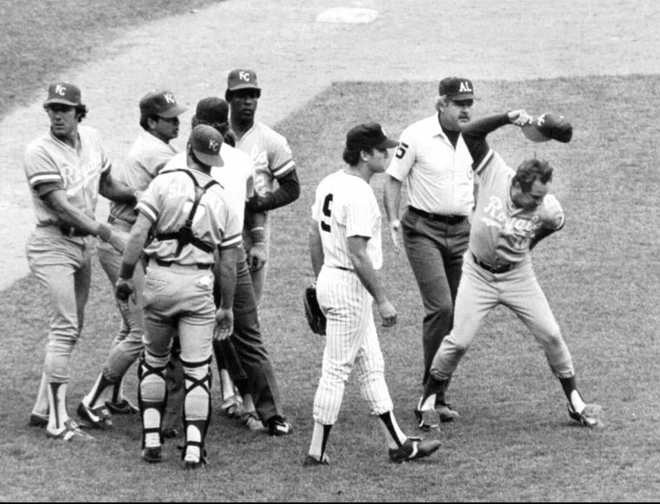 Kansas City's George Brett threw his cap after umpires disallowed a home run he hit in 1983. Mr. MacPhail (left) overruled the umpires, even though pine tar on Brett's bat exceeded the amount allowed.