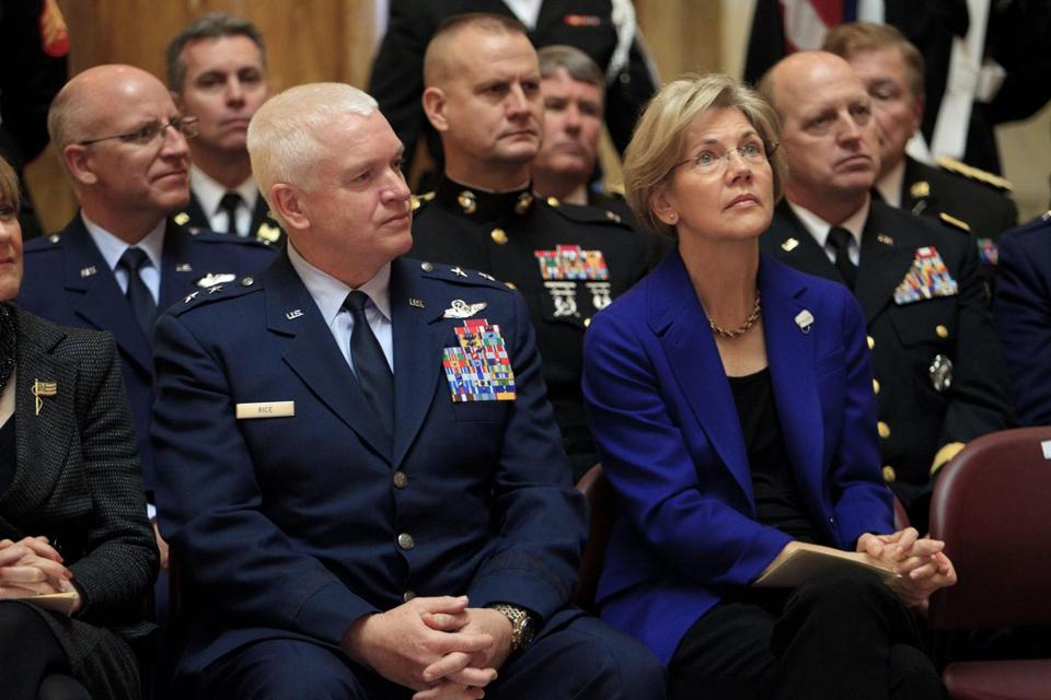 Senator-elect Elizabeth Warren and Massachusetts National Guard Major General L. Scott Rice (left) attended the Veterans Day ceremony Sunday at the State House.