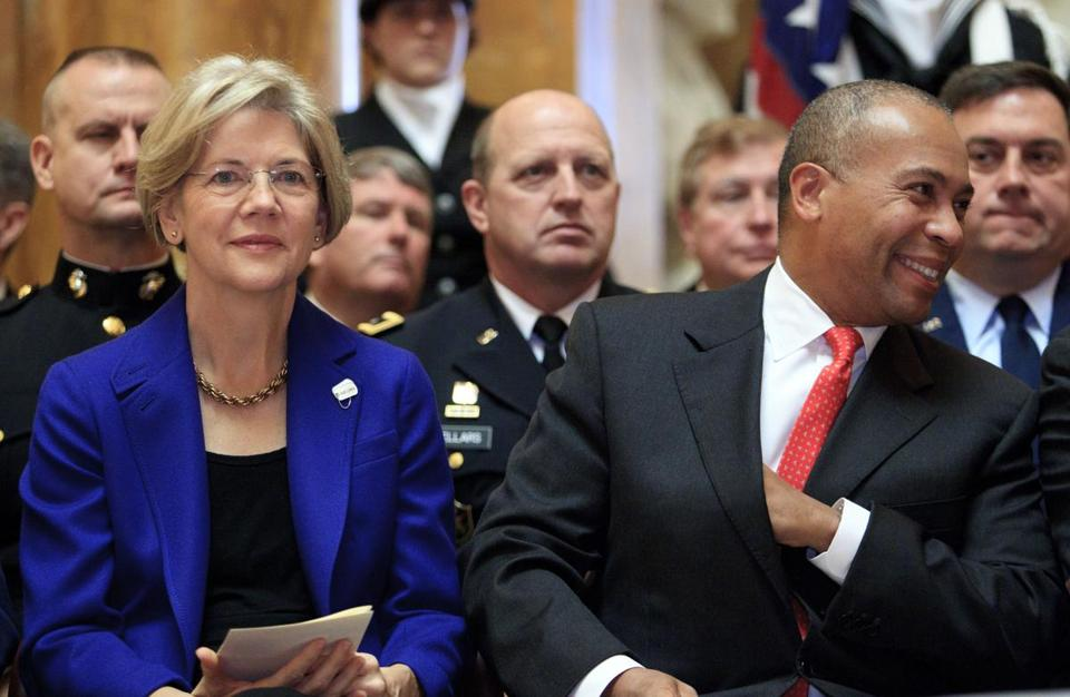 Senator-elect Elizabeth Warren and Governor Deval Patrick were among those honoring veterans and their families at a State House ceremony last Sunday.