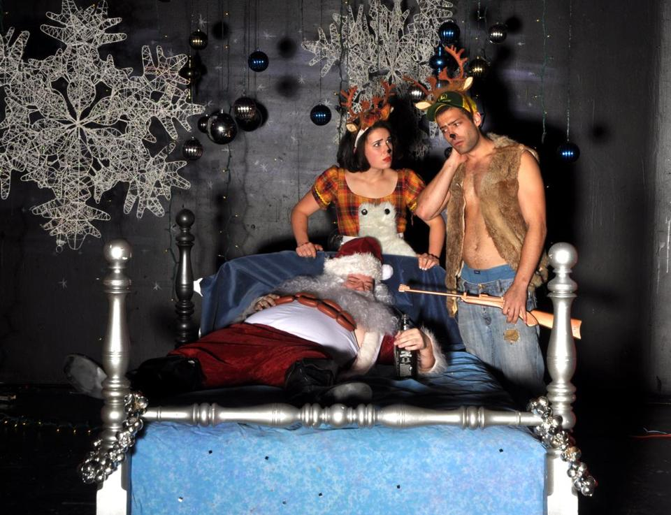 "Tim Lawton (as Santa), Grace Carney, and Jesse James Wood (as Rudolph) in the Gold Dust Orphans's ""Rudolph the Red Necked Reindeer."""