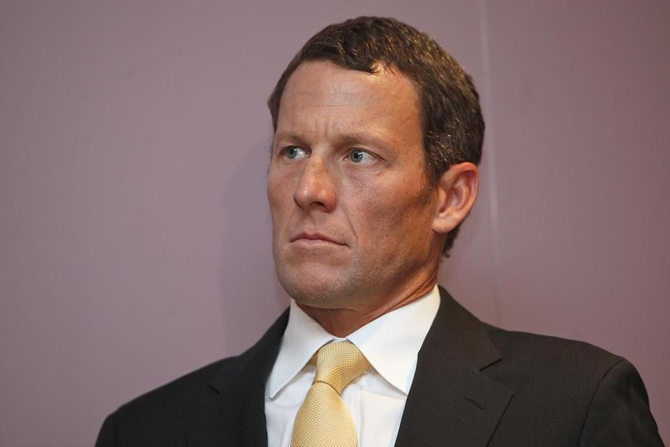 Lance Armstrong, shown in February 2011, has resigned from the board of the Livestrong foundation.