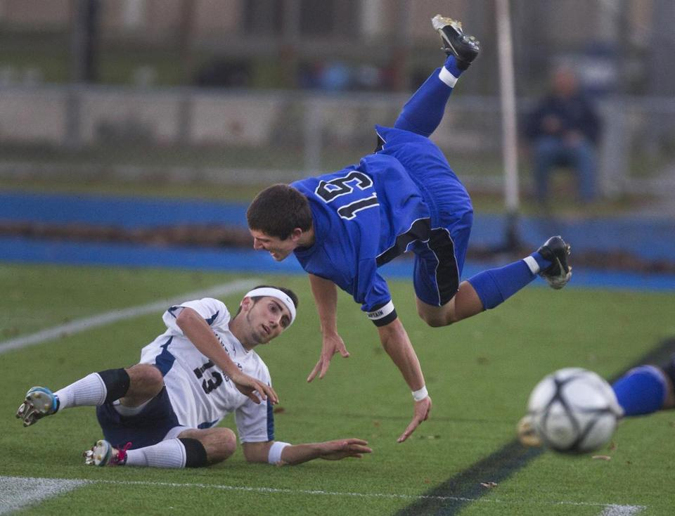 Dover-Sherborn senior captain Steven Aston gets upended by Nantucket senior Chris Sylvia in the Division 3 South soccer final, won by D-S, 3-0, at Braintree High School.