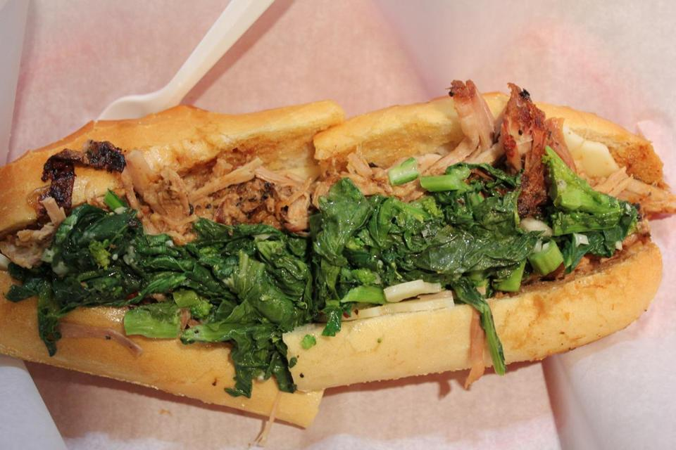 The roast pork sandwich with broccoli rabe and provolone.