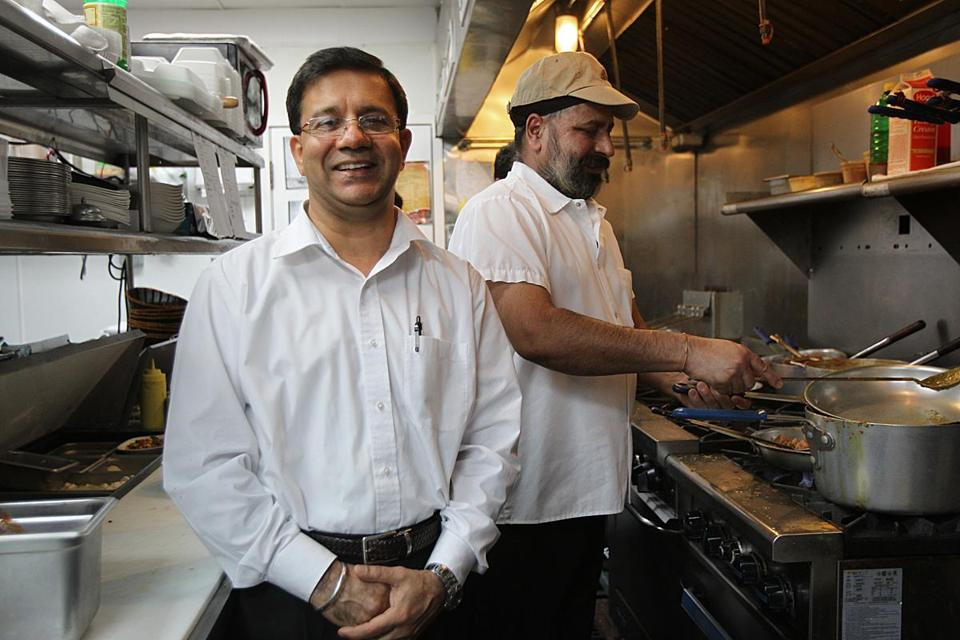 Co-owner Ajay Sachar (left) in the kitchen.