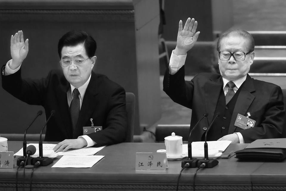 China's President Hu Jintao (left), with former President Jiang Zemin, handed over power to VP Xi Jinping.