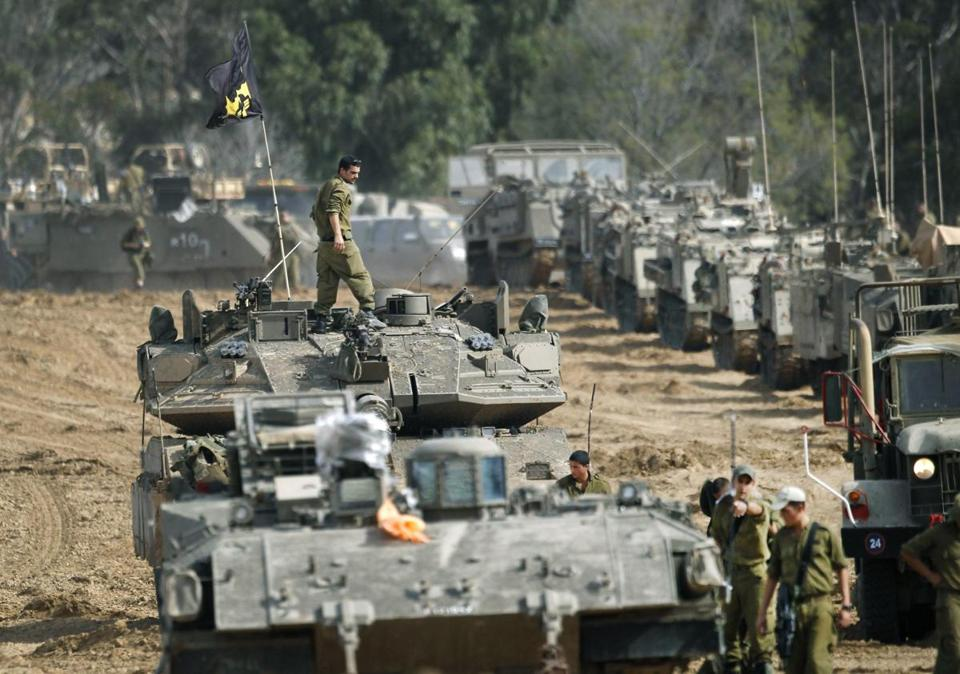 Israeli armored vehicles massed near the border with Gaza on Friday.