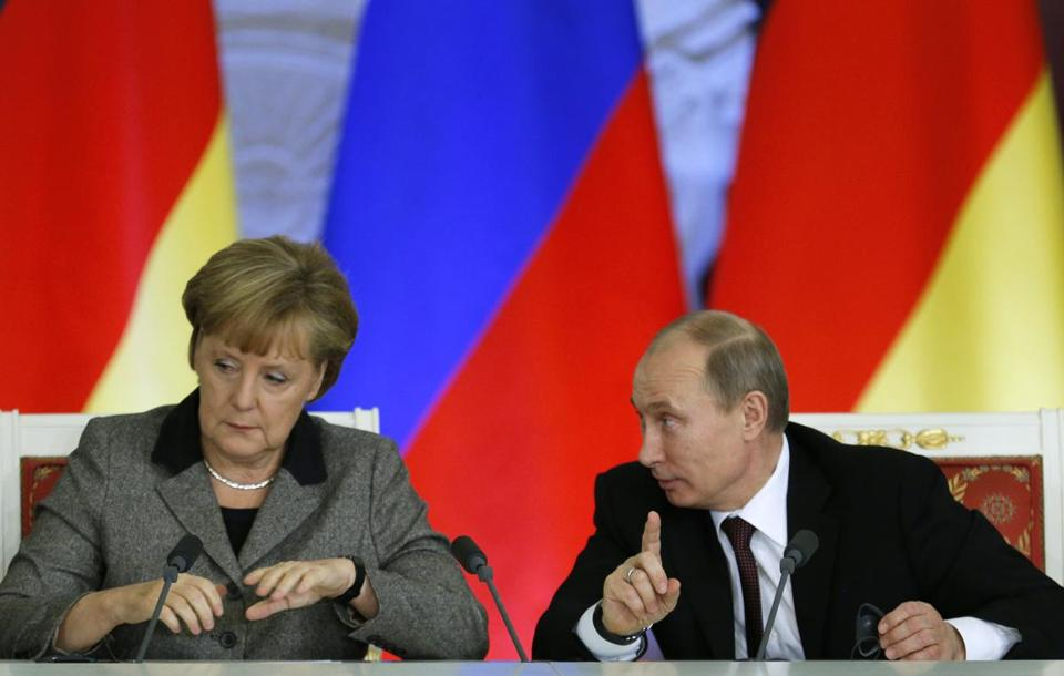 President Vladimir Putin of Russia addressed German leader Angela Merkel in Moscow.