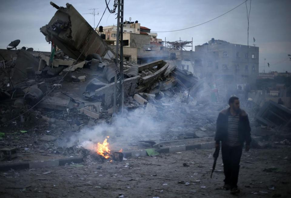 A police officer examined the area around the destroyed building that was headquarters of the Hamas prime minister, Ismail Haniyeh, after air strikes in Gaza City on Saturday.