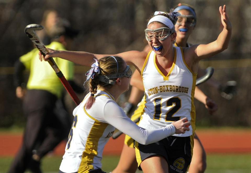 Acton-Boxboro's Eleni Neyland, left, and Eleana Cardarelli celebrated after Neyland scored the Colonials' second goal against Shrewsbury in the state final.