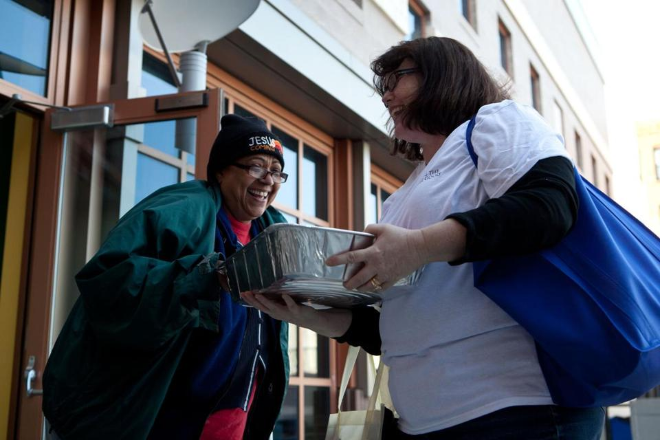 Salvation Army volunteer Bonnie Lombardi gave a pumpkin pie to Mercedes Luisa on Saturday.