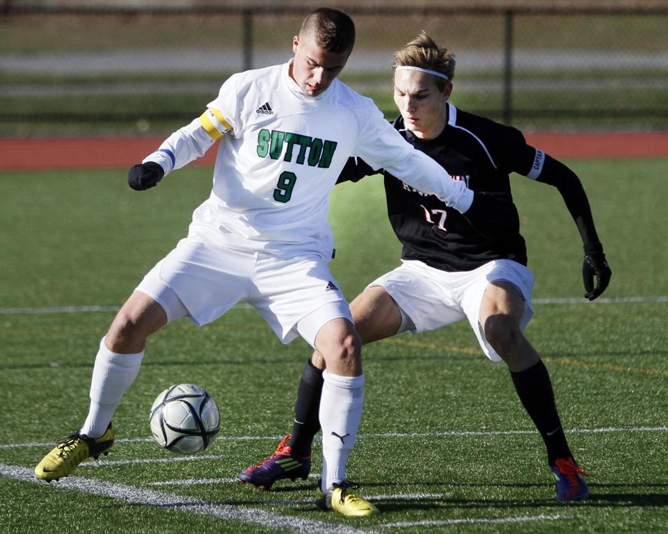 Justin Rothermich was on the ball against Watertown's James Garbier; Rothermich scored Sutton's first goal.