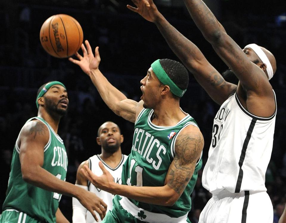 Celtics guard Courtney Lee can't find the handle with Brooklyn's Reggie Evans towering over him.