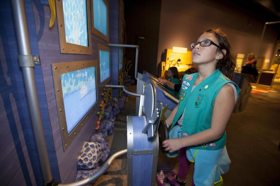 Girl Scout Andrea Davis of Raynham during an event at the Museum of Science.