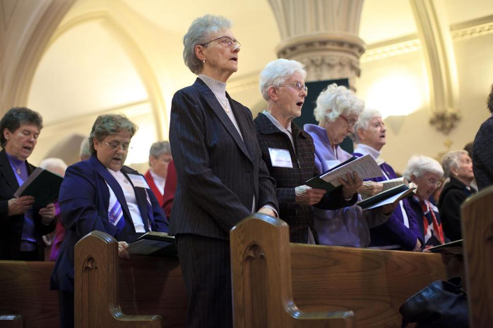 Members of Sisters of Grace prayed during the celebration for the Sisters of Charity in St. Agatha Church in Milton.