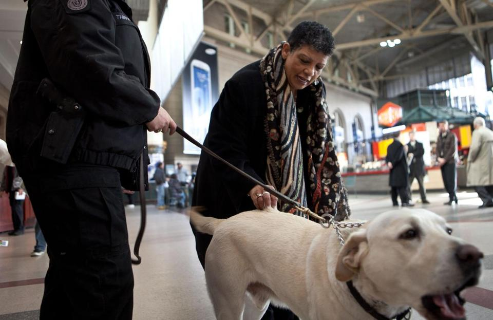 New MBTA chief Beverly Scott greeted T bomb technician Ariane Thibodeau and her working dog Max in South Station.