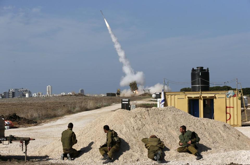 Israeli soldiers watched as an Iron Dome launcher fired an interceptor rocket near the southern city of Ashdod Sunday.