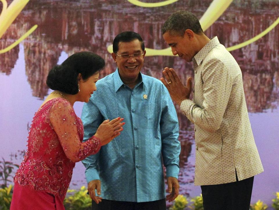 President Obama exchanged formalities with Prime Minister Hun Sen and his wife, Bun Rany, Monday in Phnom Penh, where he pressed the longtime ruler to release political prisoners, stop land seizures, and hold free and fair elections. Aides said Obama would have stayed away from Cambodia if it were not hosting regional summits.