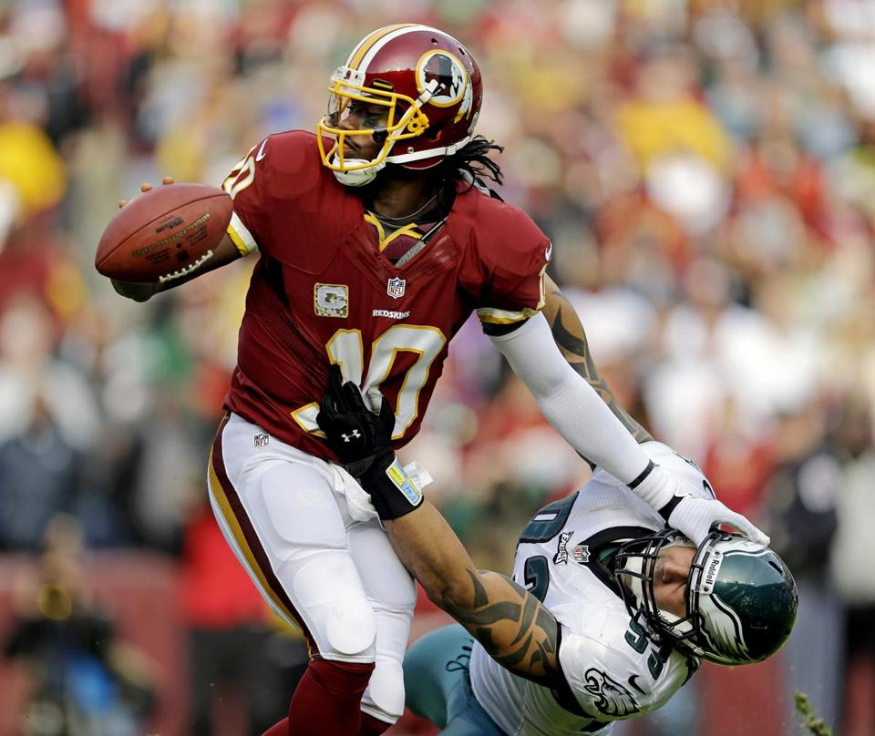 Redskins rookie Robert Griffin III, shedding the Eagles' Jason Babin, missed on just one of 15 attempts.