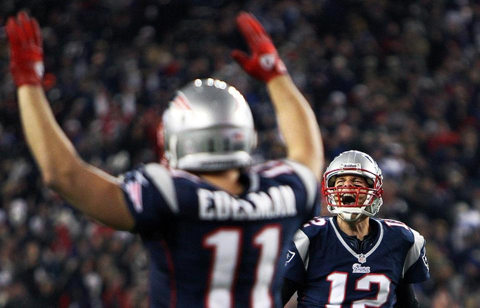 Julian Edelman (left) and quarterback Tom Brady celebrated a fourth-quarter touchdown as the Patriots thrashed the Colts on Sunday at Gillette Stadium.