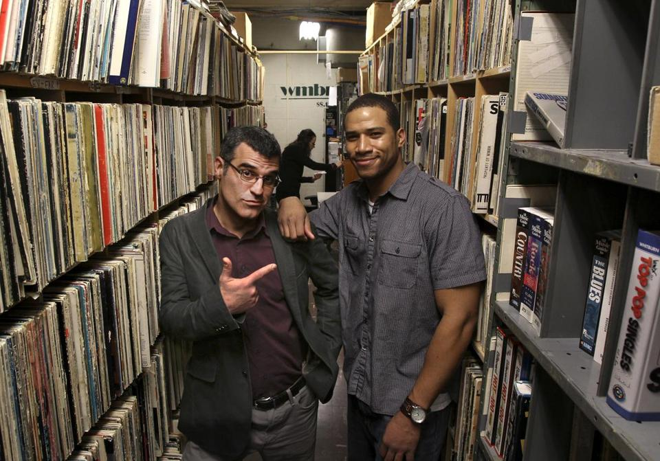 Rap historian Pacey Foster (left) and WMBR's hip-hop director Dana Scott in the radio station's music library at MIT.