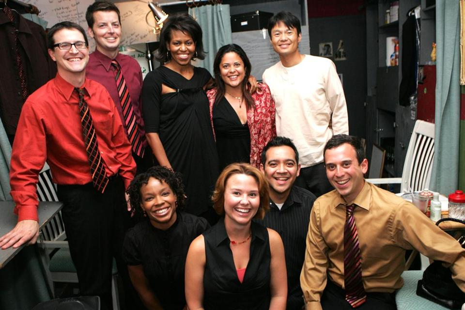 "After a 2007 Second City performance of ""Between Barack and a Hard Place,"" the cast posed with (back row, center to right) Michelle Obama and her sister- and brother-in-law, Maya Soetoro-Ng and Konrad Ng."