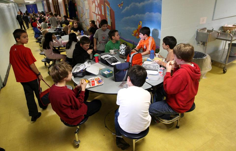 The students ate lunch in a basement hallway in 2009.