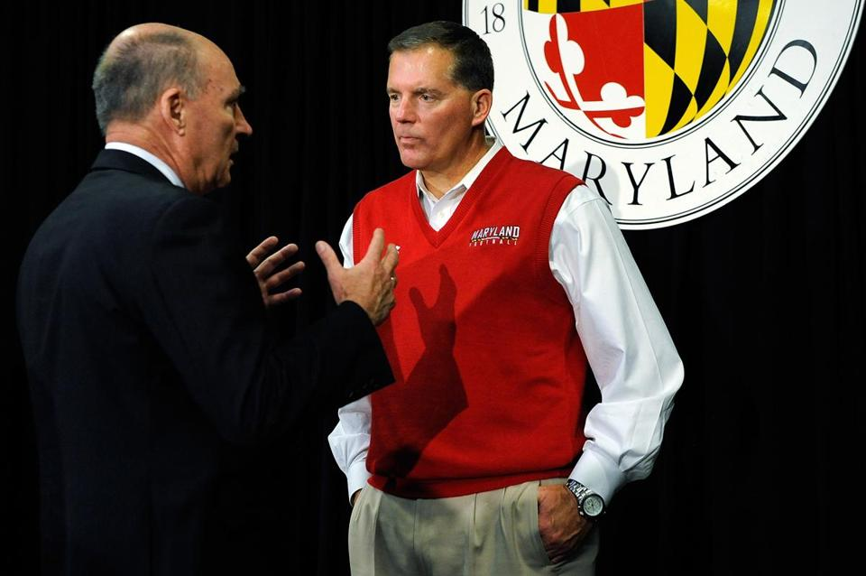 Big Ten commissioner James E. Delany (left) spoke with University of Maryland football head coach Randy Edsall after yesterday's news conference.