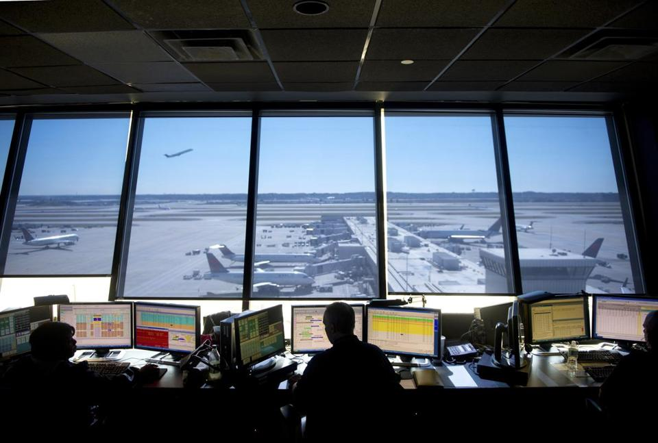 Perched in a tower, agents at Delta's coordination center in Atlanta get a panoramic view of the airport, its terminals, and the five parallel runways.