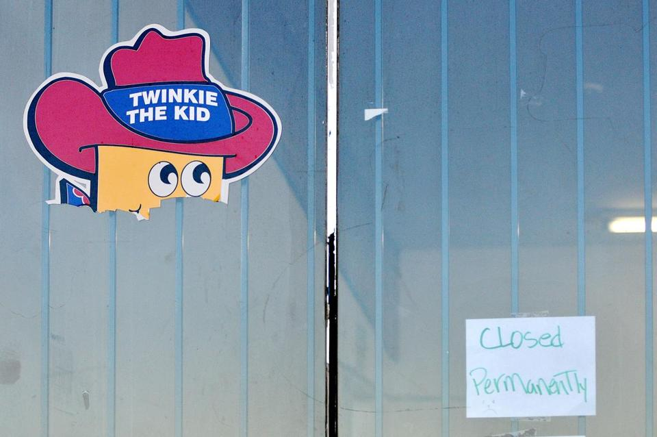 The remnants of a Twinkie poster remained Tuesday on the shuttered Hostess outlet store in Victorville, Calif.