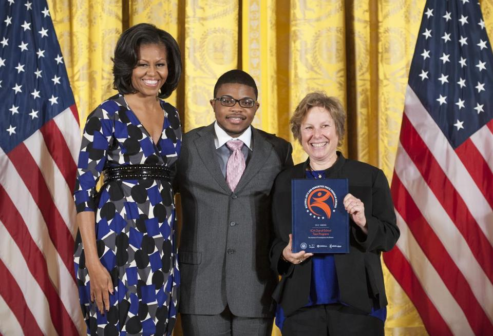 From left: Michelle Obama, Romario Accime, and ICA director Jill Medvedow at the White House.