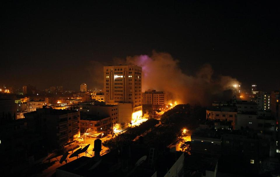 Smoke rose over Gaza City Tuesday night after an apparent Israeli air strike on the deadliest day of the fighting.