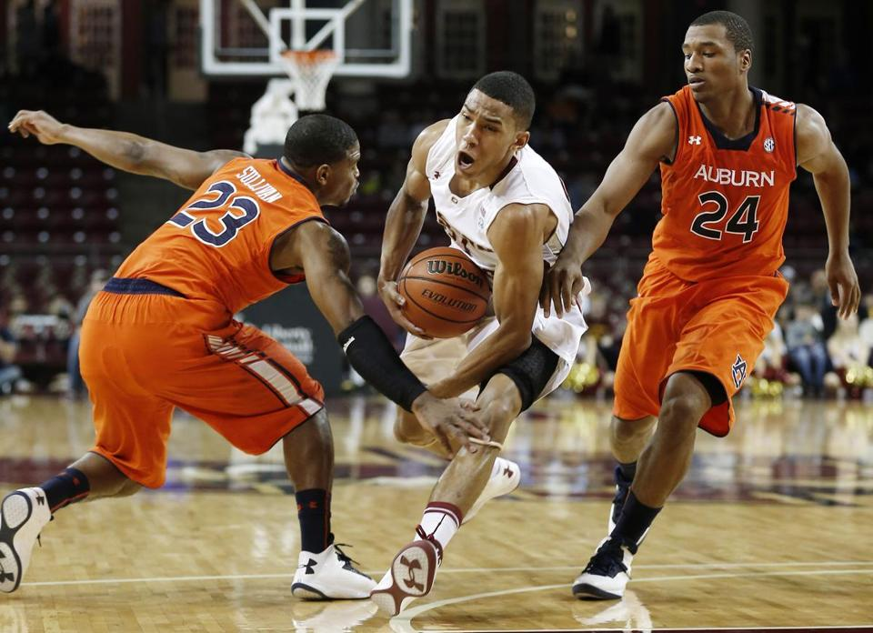 BC's Olivier Hanlan, who finished with 19 points, drives between Auburn's Frankie Sullivan (23) and Brian Greene Jr.