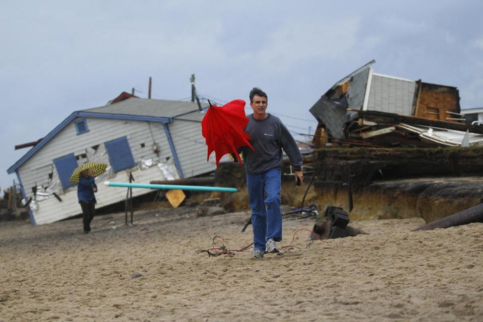 Rhode Island's Roy Carpenter's Beach was heavily damaged and cottages were destroyed by Hurricane Sandy in Matunuck last month, and much of the sand was swept away.