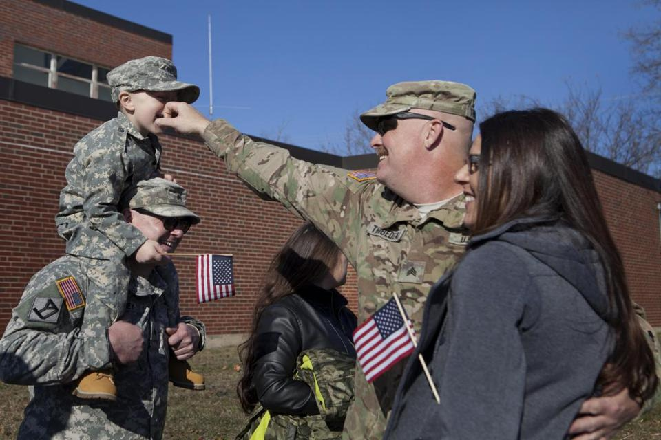 Sean Thibedeau hugged his girlfriend, Nadene Nardella, and greeted Colby Torrey, 4, and Tim Torrey at the 182nd Engineer Company's homecoming.