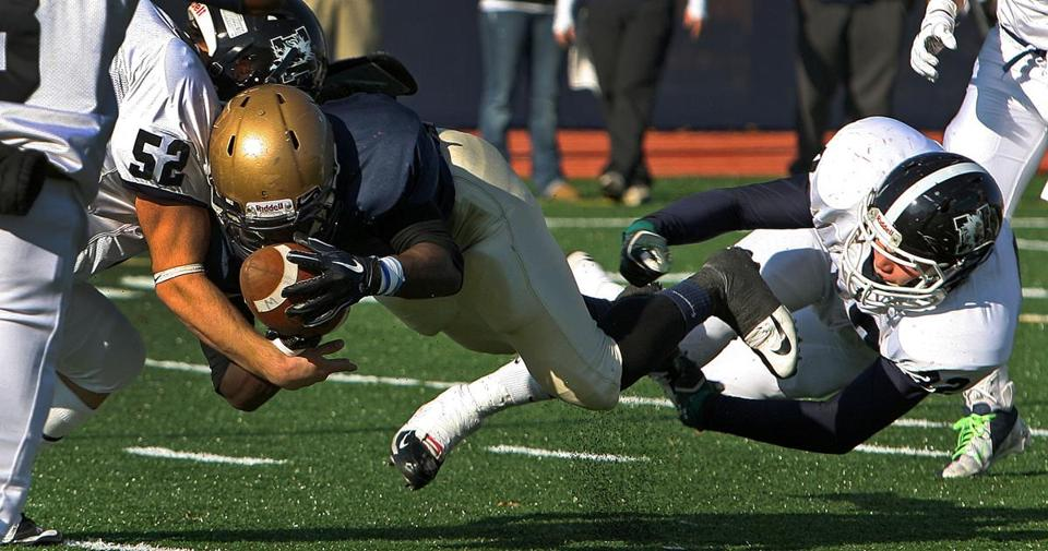 POWER MOVE — Malden's Ray Sainstril scores against Medford from one yard out last Thursday. Malden won, 32-6.