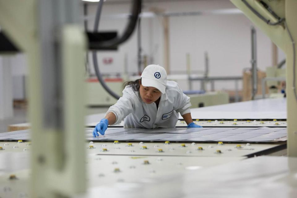 An employee examined a solar panel at Wanxiang NewEnergy in Rockford, Ill.