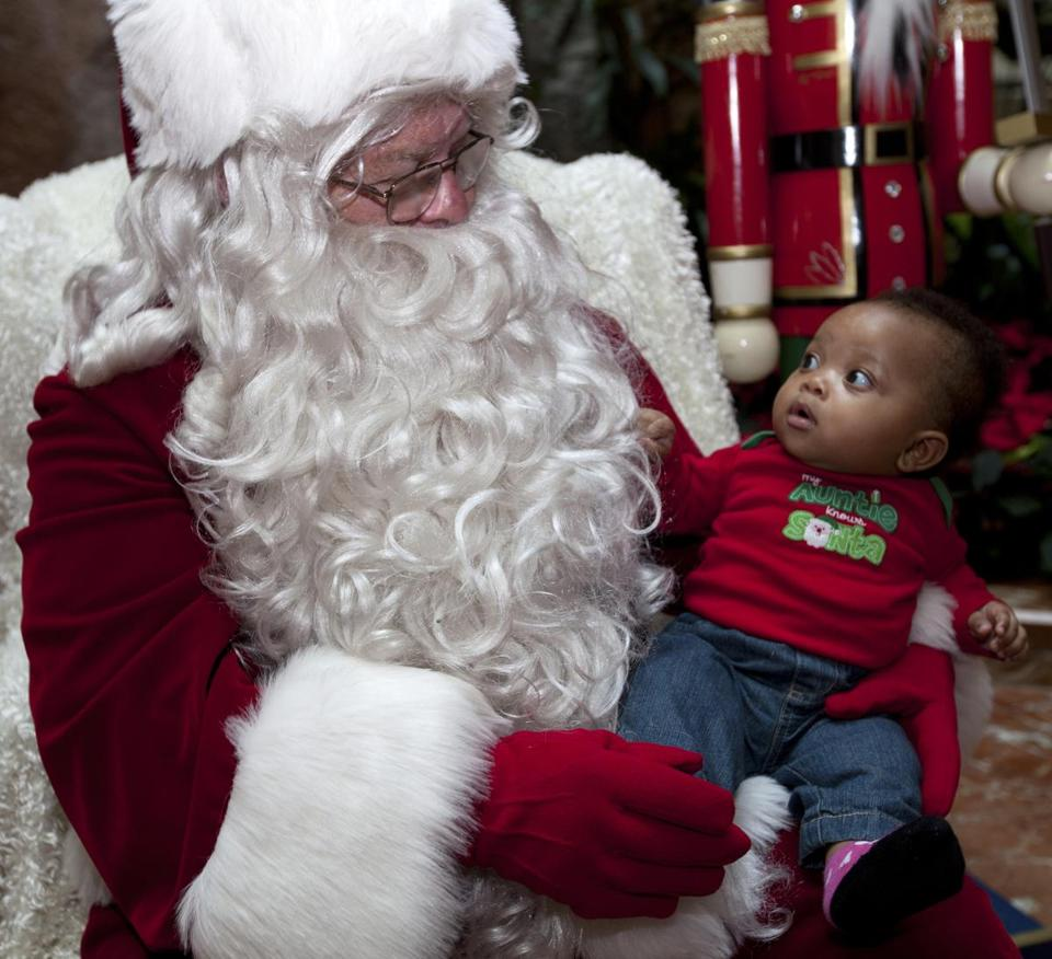 Harmonie Walker, 6 months, of Jamaica Plain, met Globe Santa for the first time at Copley Place.