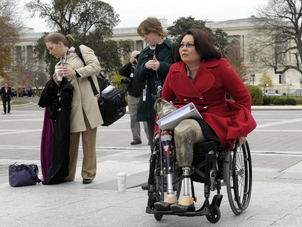 Representative-elect Tammy Duckworth of Illinois served in Iraq, where she lost her legs in combat.