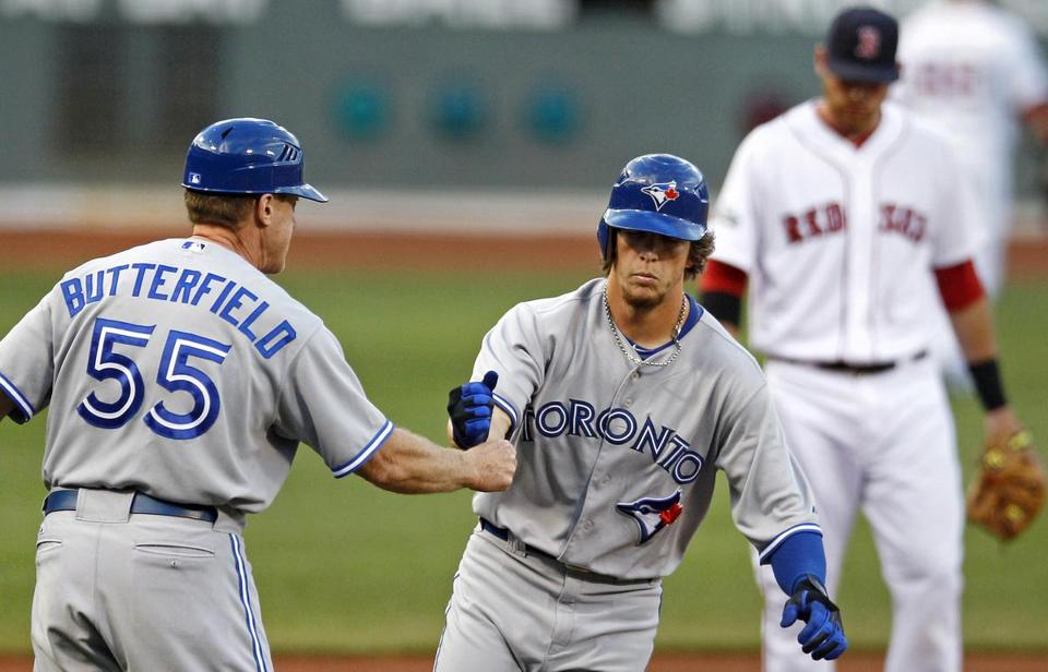 Third base coach Brian Butterfield has traded in his Blue Jays uniform for a Red Sox jersey.