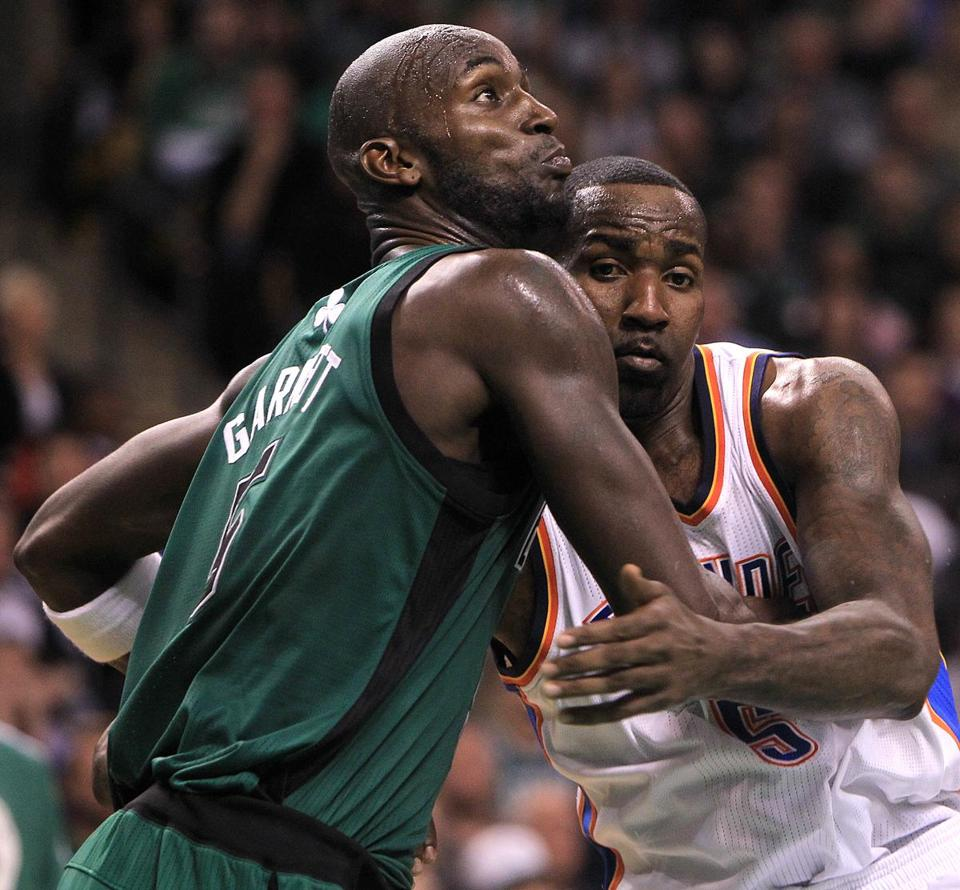 Kevin Garnett fights for position with former teammate and close friend Kendrick Perkins, now with the Thunder.