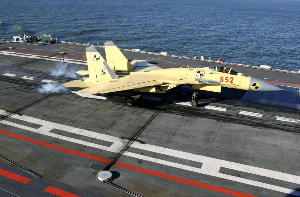 The landing marked the debut of the carrier-based J-15 fighter-bomber, modeled on Russia's Sukhoi Su-33.