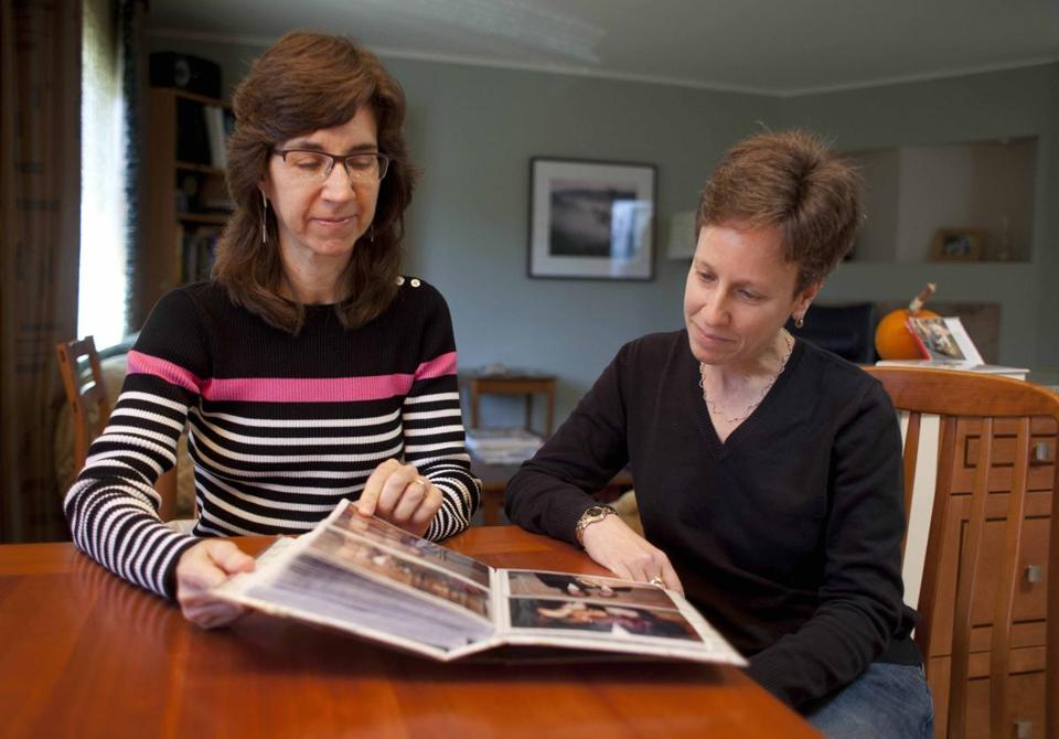 Karen Golinski (left), a federal employee, has sued to add her wife, Amy Cunninghis, to her health insurance plan.