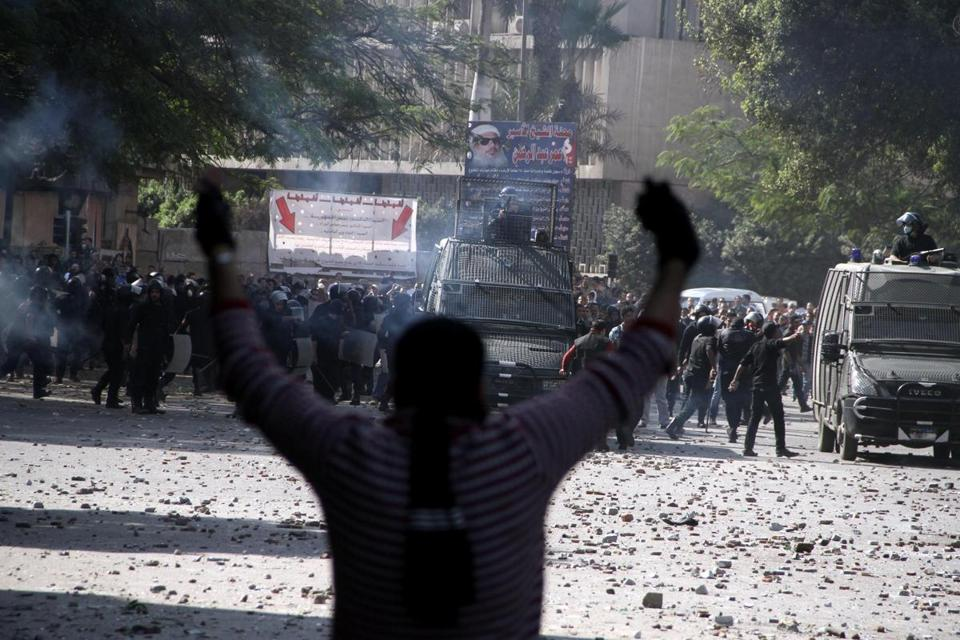Egyptian security forces and protesters clashed near Tahrir Square in Cairo on Sunday.