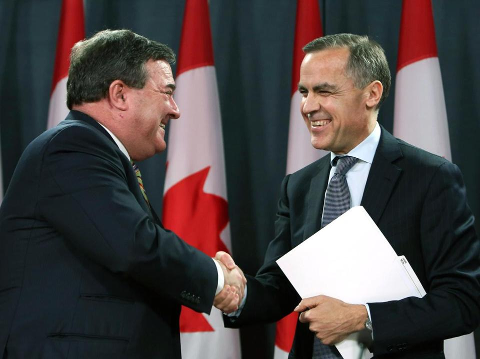 Mark Carney (right) was congratulated on his new UK post Monday by Canadian Finance Minister Jim Flaherty.
