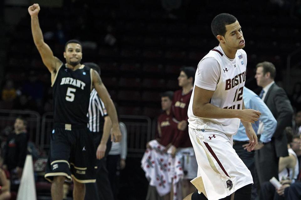 Bryant's Frankie Dobbs and BC's Ryan Anderson have different reactions after Anderson's last-second miss.