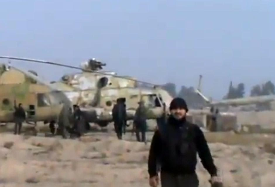 In this image from video, rebels took a helicopter air base near Damascus following fierce fighting on Sunday.